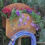 Soporte jardinera para manguera de jardin